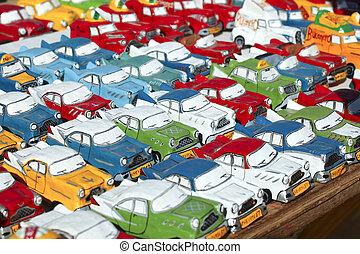 Miniature oldsmobiles - Rows of model oldsmobiles at market ...