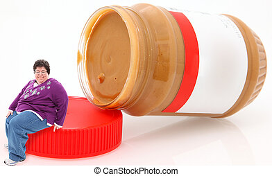 Miniature overweight happy forty year old woman sitting on peanut butter jar lid.