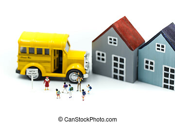 Miniature people : A group of young children getting on the schoolbus, schoolbus transportation education