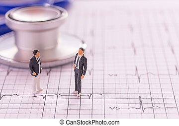 Miniature people : Businessman figures standing on the cardiovascular medical exam