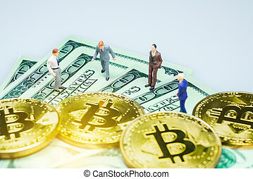 Miniature people : Businessman with golden bitcoin and US dollar bills.