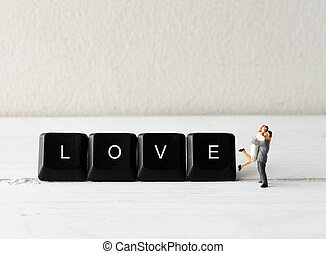 miniature people couple hugging with computer keyboard button 2018 new year concepts