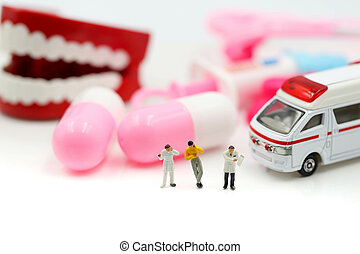 Miniature people : Doctor and Paramedic attending to patient in ambulance, Medicine ambulance concept