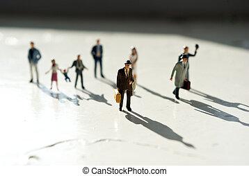 miniature people in travel on sun