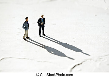miniature people - miniature man's on white with shadow