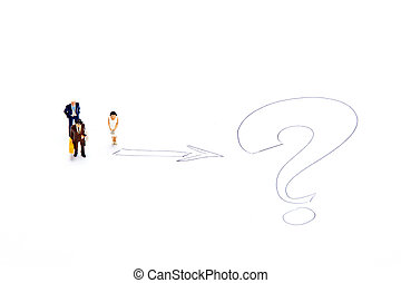 Miniature people on white with some diagrams