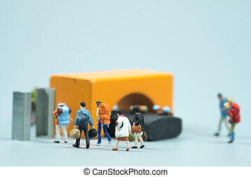 Miniature people passenger walking through metal for detector airport security check