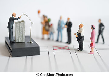 Miniature people : politician or party candidate in excited speech persuades