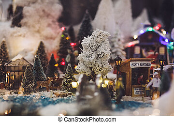 Miniature people relax at Christmas