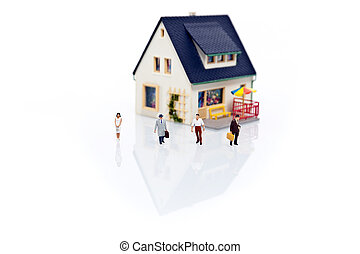 miniature people with house