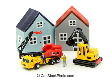 Miniature people : worker team for building home ,Image use for construction, business concept, house repair or home renovating