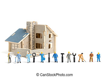 Miniature people : Worker team with tools supplies for repair house on white background