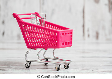 Miniature Pink Toy Shopping Cart on White Background