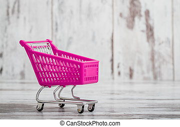 Miniature Purple Toy Shopping Cart on White Background