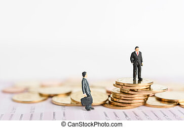 Miniature successful businessman stand on top of golden coins with book bank background