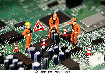 Miniature technicians fixing electronics