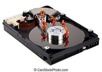 Miniature technicians work on hard drive