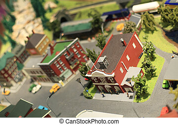 Miniature town with streets, roads, cars, people and houses
