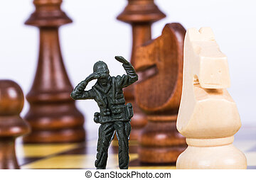 Miniature Toy Soldier on Chess Board