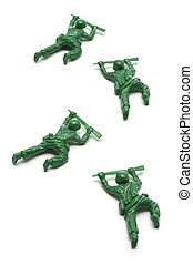 miniature toy soldiers advancing creeping on white...