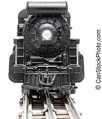 A miniature replica of a steam powered train.
