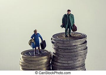 miniature woman and man on piles of euro coins - closeup of ...