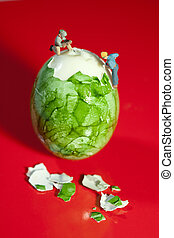 Miniature Workmen Peeling Egg - Two miniature workmen ...