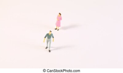 Miniatures of men and women appear on screen, time lapse