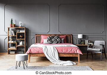 Minimal grey bedroom interior - Grey armchair next to pink...