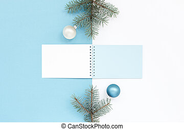 Minimal New Year`s card with notebook, pine, Christmas balls. Abstract geometric light blue and white holiday background, celebration preparation