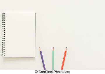 Minimal work space - Creative flat lay photo of workspace desk with sketchbook and wooden pencil on copy space white background. Top view , flat lay photography.