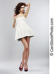 Minimalism. Fashion Style. Stylish Woman in Light White Dress. Summer Collection