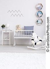 Minimalist baby room with cradle