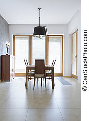 Minimalist dining room with wooden table