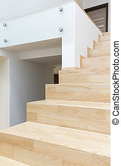Minimalist hallway and wooden stairs in modern style
