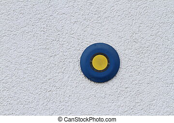 button on grunge wall