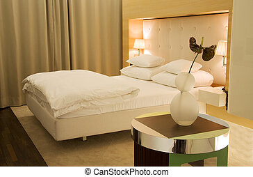 Stylish minimalistic bedroom in white and beige