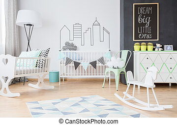 Minimalistic decorations in modern baby room
