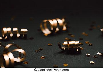 Minimalistic golden decor on black stylish background.