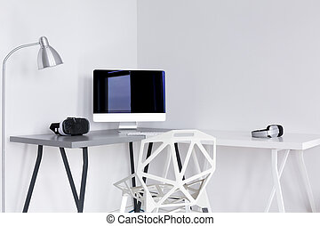 Minimalistic home office area in white