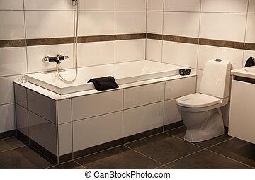 Minimalistic modern clean lines design bathtub in a trendy tiled bathroom