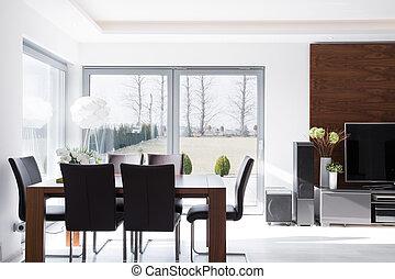Interior of minimalistic modern bright dining room