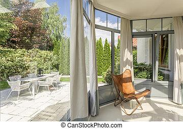 Minimalistic orangeria with garden view