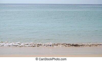 Minimalistic slow motion shot of sea tide on sandy beach...