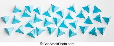 blue paper tetrahedrons on white background. abstract web banner