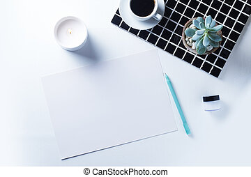 work place - minimalistic work place with emty white sheet. ...