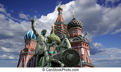 Minin and Pojarsky monument (was erected in 1818) near the Saint Basil cathedral (Temple of Basil the Blessed) against the moving clouds, Red Square in Moscow, Russia