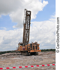 Mining Drill Rig in Africa planting explosives to release...