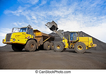Mining Dump Truck and wheel loader for transporting Manganese for processing