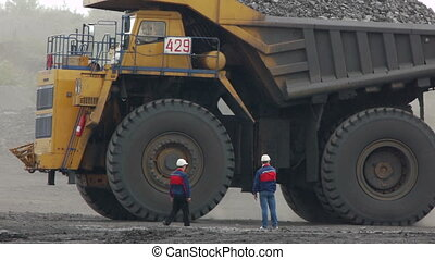 Mining dump trucks in the open pit